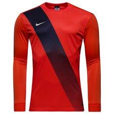 Sash spilletrøje, med lange ærmer, fra amerikanske Nike, som er lavet med et komfortabelt fit. Trøjen har Nike-logo på højre bryst, rund hals, samt meshpanel