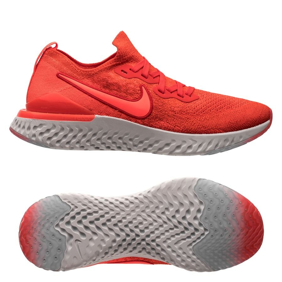 red and gray nike running shoes